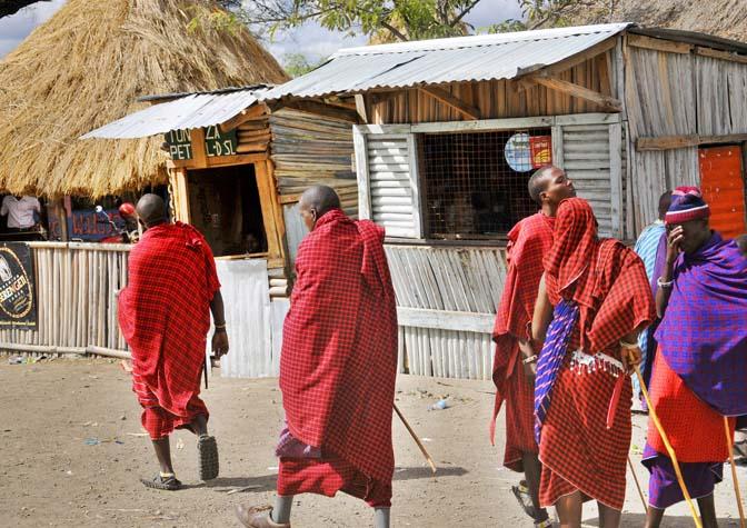 bigstock-Masai-walking-through-the-Arus-41323903