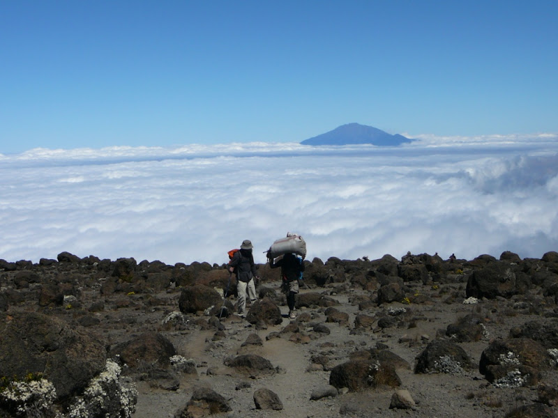 Hiker and porter Mt. Kilimanjaro