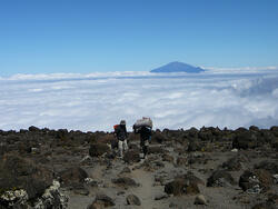 Hiker and porter Mt. Kilimanjaro
