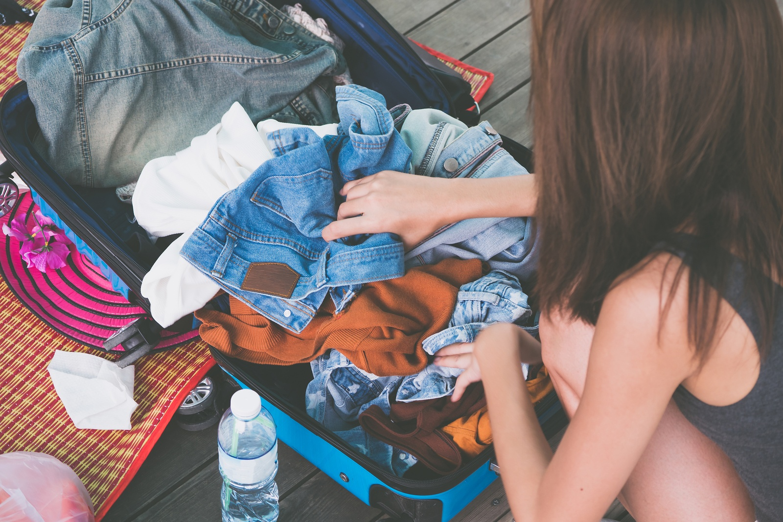 bigstock-Woman-Packing-Clothes-Into-A-T-244895476 (1).jpg