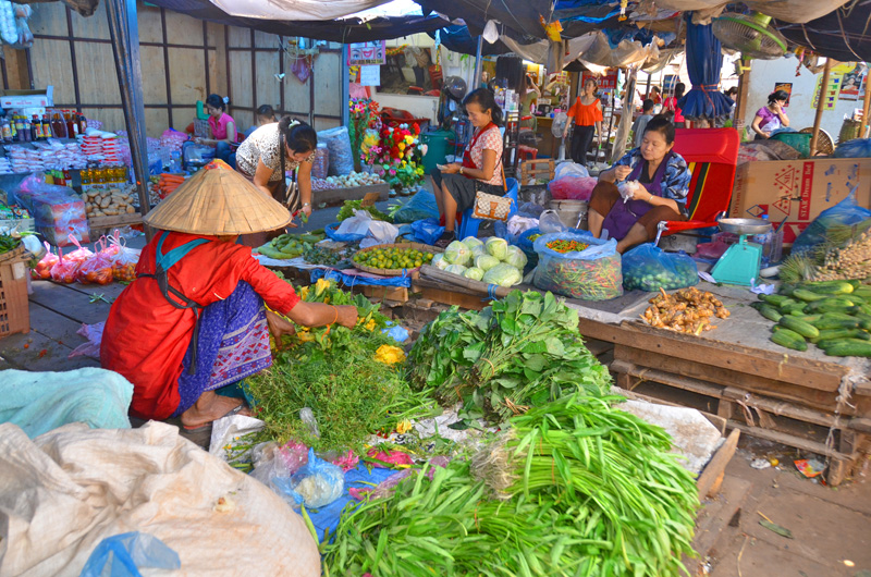 bigstock-Woman-sells-vegetables-45128647